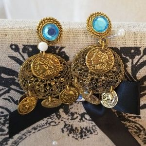Gold colored and blue stone earrings